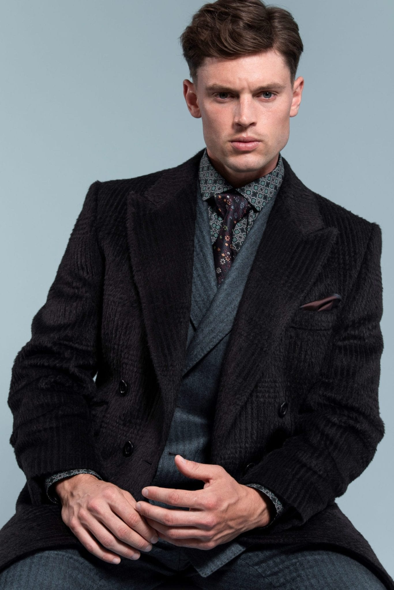 Model Jordan Clyde wearing a Custom-made wool mens overcoat